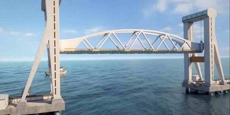 दक्षिण भारत के तमिलनाडु में देश का पहला वर्टिकल लिफ्ट रेलवे सी ब्रिज (First Vertical Lift Railway Sea Bridge) जल्द ही बनकर तैयार हो जाएगा. 9 नवंबर 2019 को इस नया पंबन ब्रिज (Pamban Bridge) का निर्माण शुरु हुआ था और आने वाले मार्च तक इसके पूरे होने की संभावना है. पंबन पुल से तीर्थयात्रियों और माल ढोने वाले ट्रेनों के लिए रामेश्वरम (Rameswaram) आने-जाने में आसानी होगी. बता दें कि हर साल लाखों तीर्थयात्री (Pilgrims) रामेश्वरम पहुंचते हैं. यहां विश्वप्रसिद्ध रामनाथस्वामी मंदिर है. (Photo: The  Hindu)